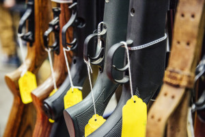AUGUSTA, ME - JANUARY 16: Guns on a rack for sale at Craig Taylor's table at the gun show held in the Augusta Civic Center in Augusta, ME on Saturday, January 16, 2016. Taylor derives most of his business from selling collectible guns, but was selling mostly hunting rifles and a few collectibles on Saturday. (Photo by Whitney Hayward/Staff Photographer)