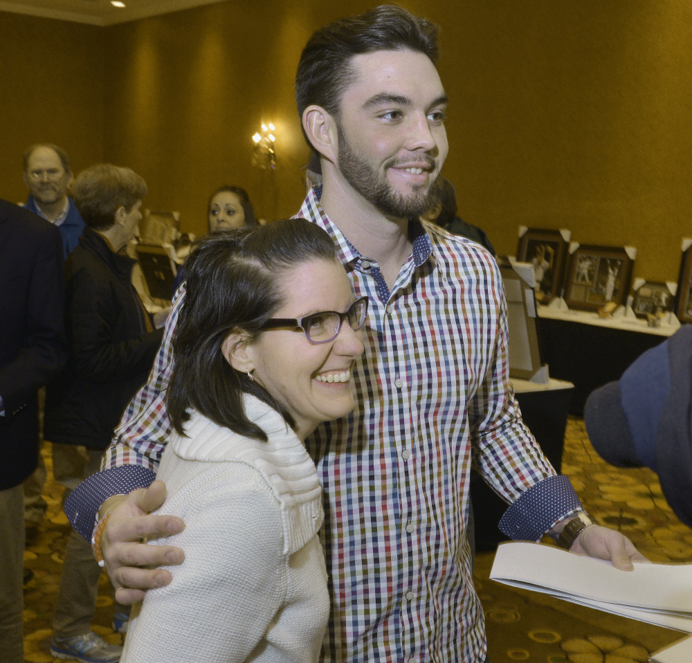 Blake Swihart, who had an impressive first season with the Boston Red Sox, poses for a photo with Janelle Boehm of Sebago during the Sea Dogs' annual dinner Friday night.
