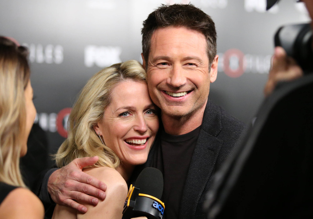 """Gillian Anderson and David Duchovny say working on """"The X-Files"""" left a mark on them. """"It took a good decade for me to start thinking of it as the gift that it was,"""" Anderson said."""