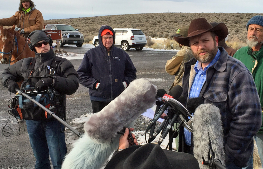 Ammon Bundy speaks to reporters at the Malheur National Wildlife Refuge in Burns, Ore., on Thursday, as the standoff over the disposition of public lands continues.