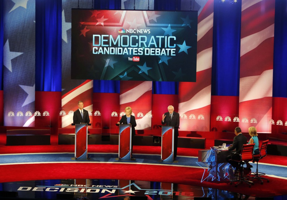 Sen. Bernie Sanders, I-Vt, right, delivers his opening statement at the NBC, YouTube Democratic presidential debate at the Gaillard Center on Sunday in Charleston, S.C. To the left is former Maryland Gov. Martin O'Malley and to the center is Hillary Clinton.