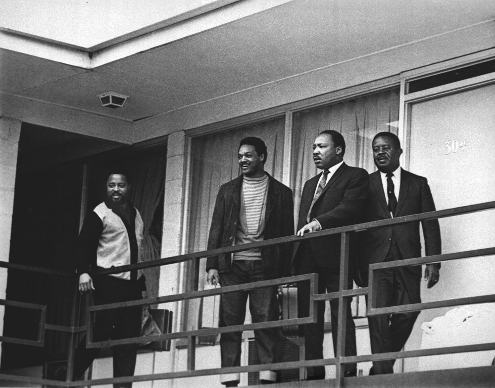The Rev. Martin Luther King Jr., in this 1968 photo, stands with other civil rights leaders on the balcony of the Lorraine Motel in Memphis, a day before he was assassinated. From left are Hosea Williams, Jesse Jackson, King and Ralph Abernathy. King is one of America's most famous victims of gun violence.