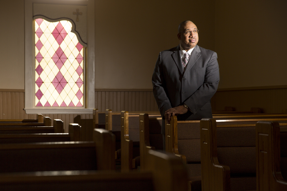 The Rev. Kenneth Lewis of Green Memorial AME Zion Church in Portland, seen at the church in January, will host Tuesday's community gathering. Ben McCanna/Staff Photographer