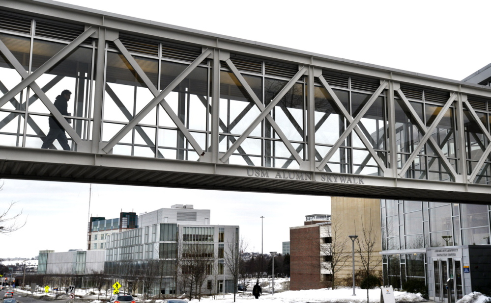 A University of Southern Maine student uses the Bedford Street skywalk to get to classes on the Portland campus, one of the possible locations for an envisioned graduate school.