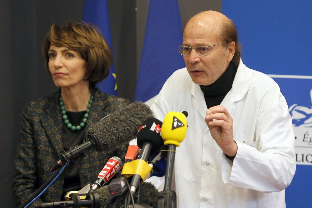 French Health Minister Marisol Touraine, left, and professor Gilles Edan, chief neuroscientist at Rennes Hospital, hold a news conference in Rennes, western France, on Friday. Six previously healthy medical volunteers were hospitalized – including one man who has since died – after taking part in a botched drug test at the Biotrial lab in western France, the French Health Ministry said.