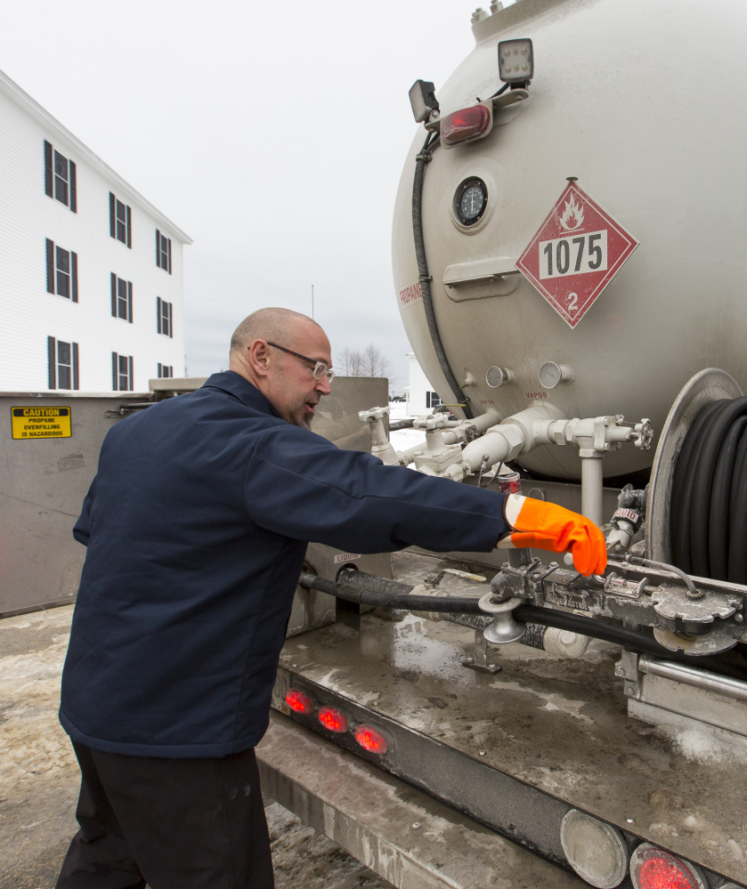 Dave Marr of Fielding's Oil and Propane Co. delivers propane Friday to a housing development in Scarborough.