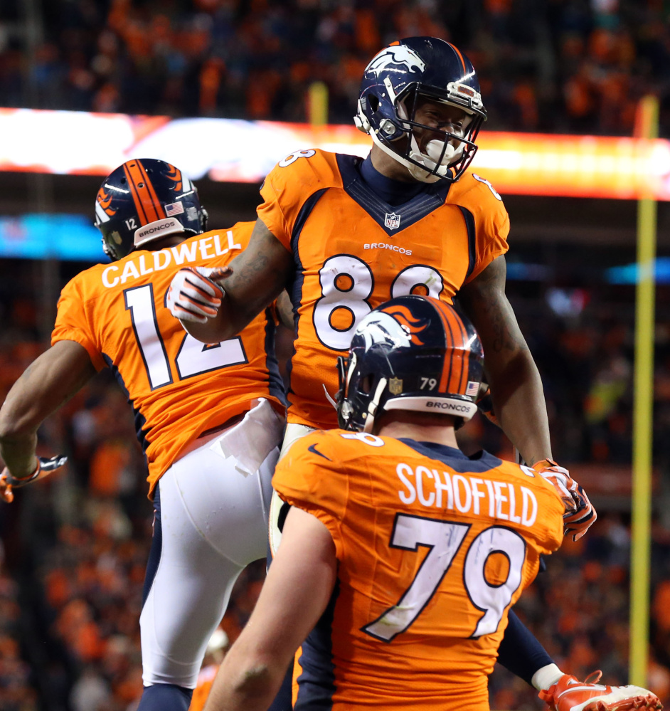 Broncos wide receiver Demaryius Thomas celebrates with teammates after catching a 2-point conversion pass in the fourth quarter Sunday, helping Denver earn a spot in the AFC championship game with a 23-16 win over the Steelers.