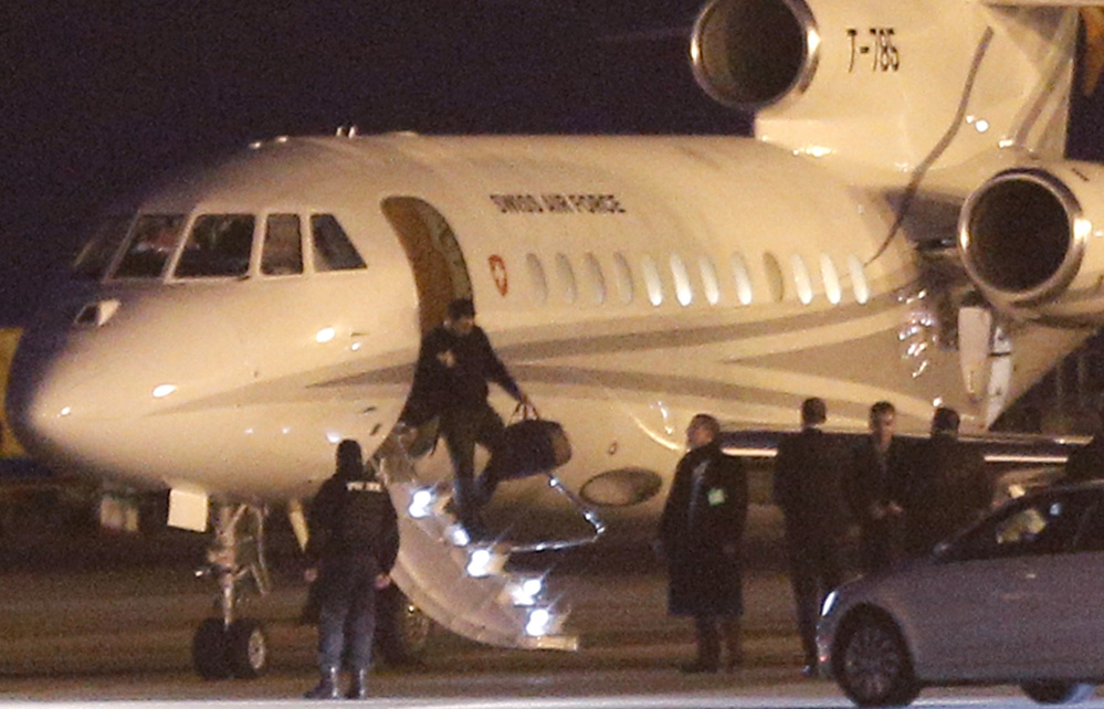 An unidentified man leaves a Swiss air force jet Sunday in Geneva, Switzerland, where a U.S. government plane waited nearby for the men who were freed from imprisonment in Iran.
