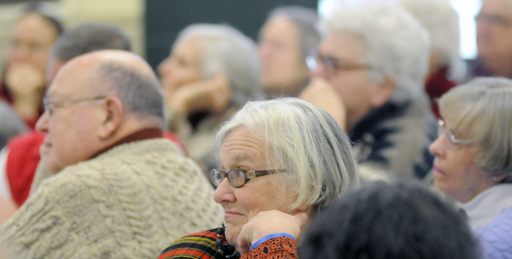 Guests listen Monday to panelists during a Martin Luther King Day forum at St. Francis Xavier Roman Catholic Church in Winthrop.