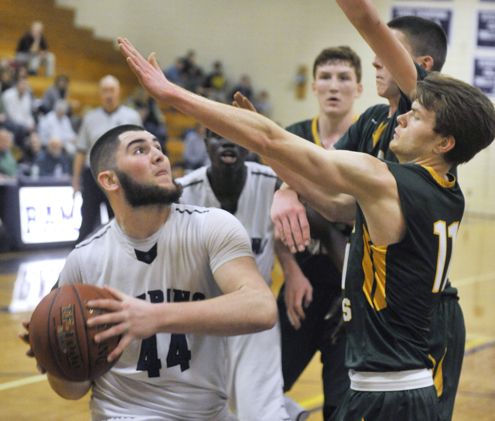 Raffaele Salamone of Deering looks for room to get off a shot while defended by Cole Verrier of Oxford Hills during a Class AA North basketball game Monday in Portland. Deering improved to 11-1 with an 81-59 win.