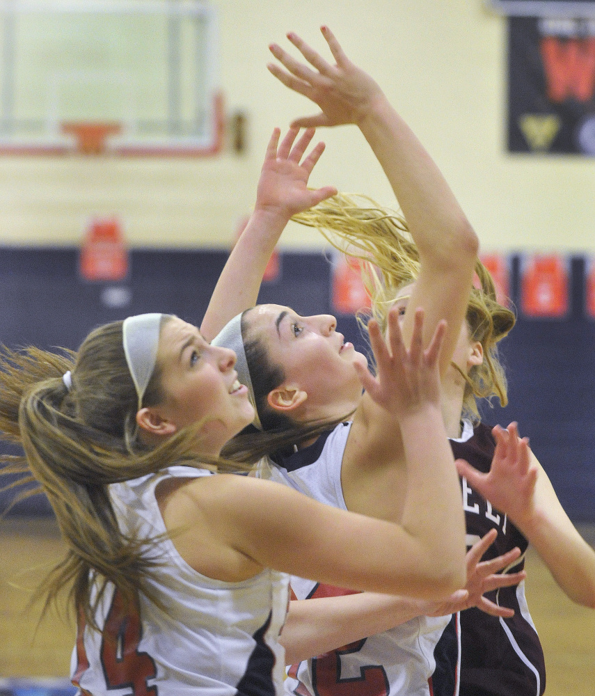 Gray-New Gloucester's Emily Thibeault, left, and Brianna Jordan battle for a rebound against Greely on Monday afternoon. Both teams are 10-3.