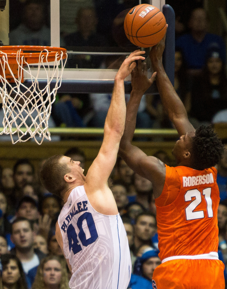 Duke's Marshall Plumlee, left, blocks a shot by Syracuse's Tyler Roberson during a 64-62 win by Syracuse at Cameron Indoor Stadium in Durham, North Carolina, on Monday.