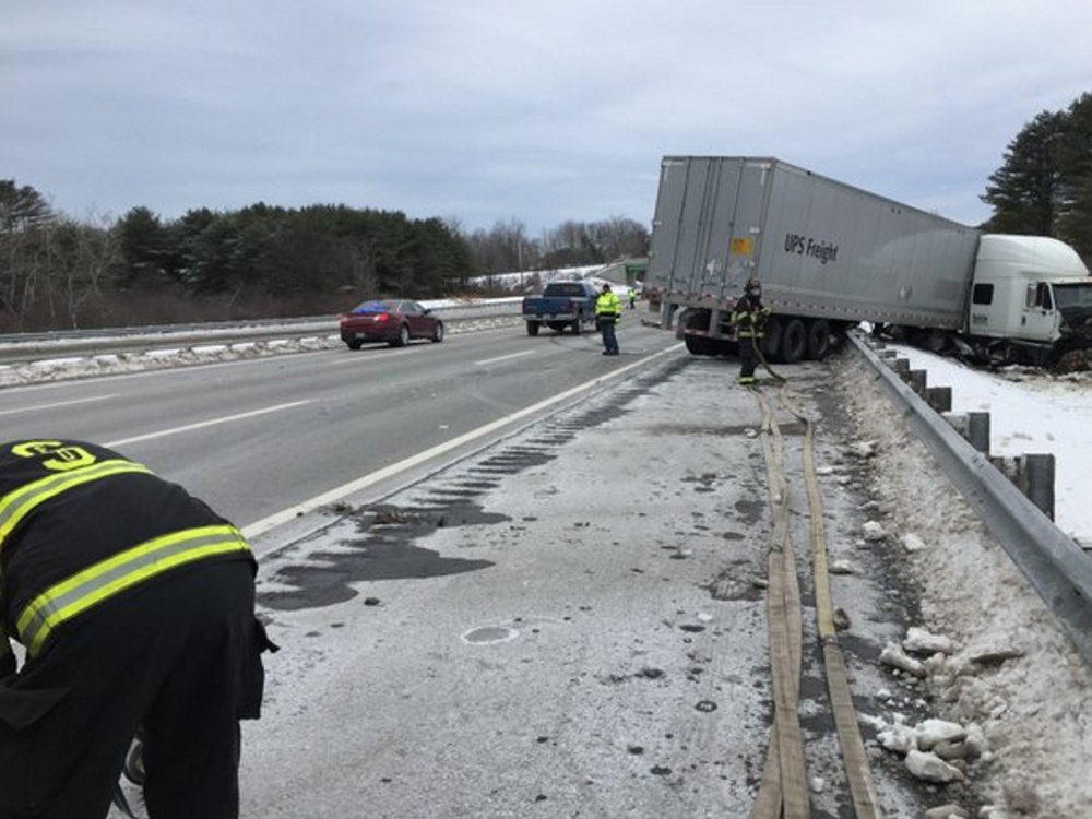 Courtesy Maine State Police A tractor-trailer lies alongside the Maine Turnpike in Scarborough on Tuesday after a multi-vehicle crash.