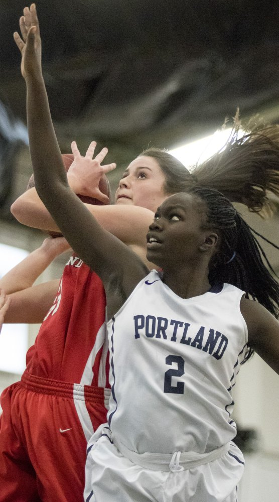 Maddie Hasson, going up for a layup against Portland's Manuela Francis during a recent game, has developed into a terrific rebounder. She is averaging more than 13 per game, best in the SMAA by more than three a game.