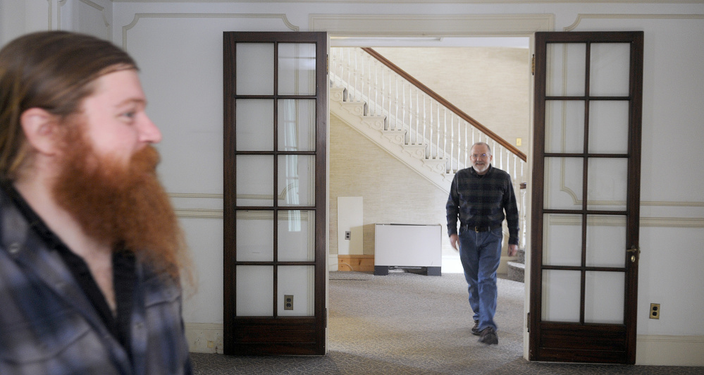 AUGUSTA, ME - JANUARY 19: Tyler Quist, left, and his father, David, explore Tuesday January 19, 2016 the Gannett House in Augusta during an announcement by the heirs of publisher Guy Gannett that the former state office building will be converted into a First Amendment museum. Tyler Quist, of Freeport, is Gannett's great grandson.(Staff photo by Andy Molloy/Staff  Photographer)