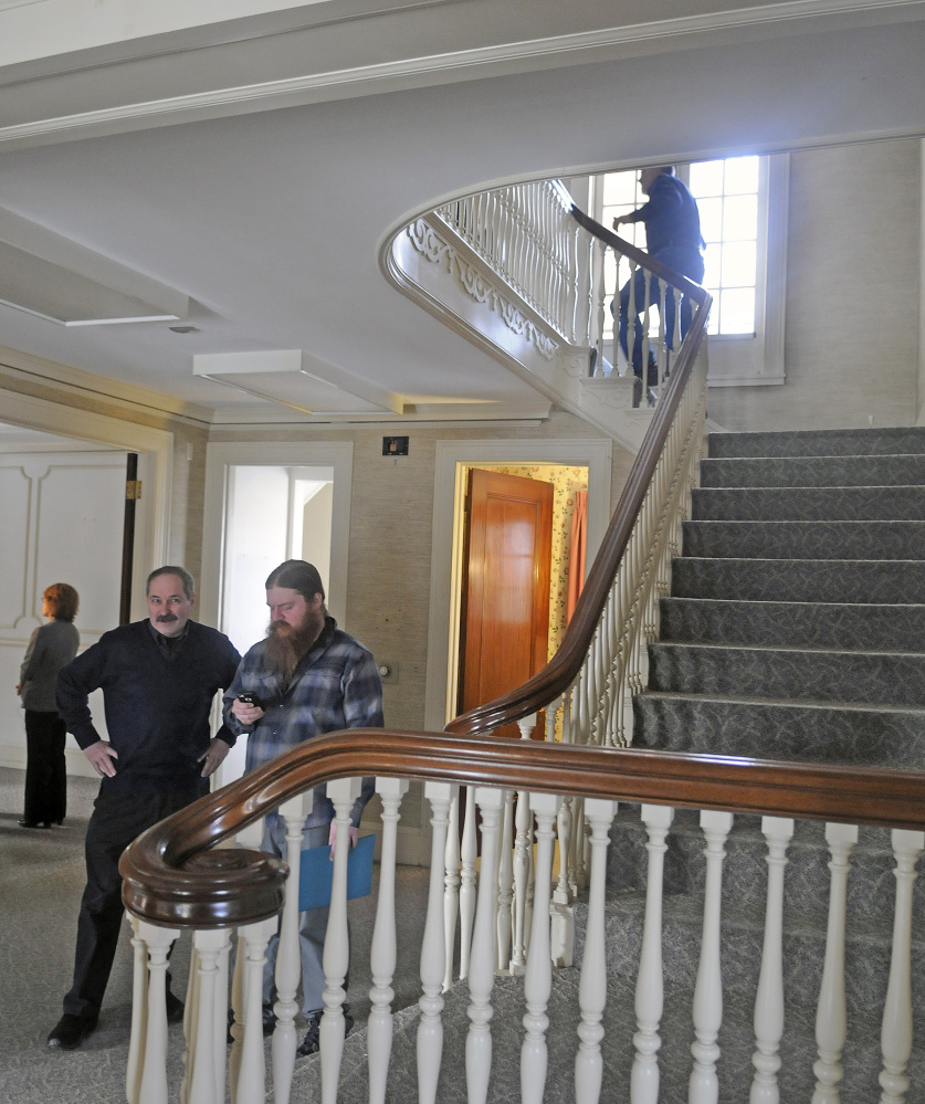 Guests explore the Gannett House in Augusta on Tuesday during announcement by heirs of Maine publisher Guy Gannett that the former state office building will be converted into a First Amendment museum.