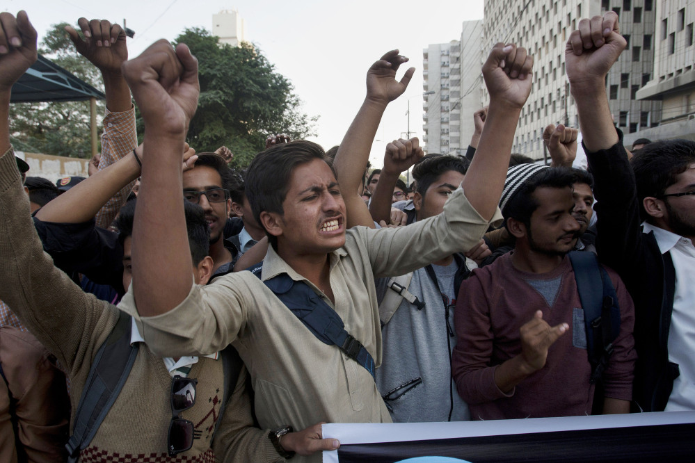 Members of the student wing of a Pakistani religious group Jamaat-e-Islami chant slogans during a demonstration in Karachi to condemn the attack by Taliban gunmen on Bacha Khan University in northwestern Pakistan on Wednesday.