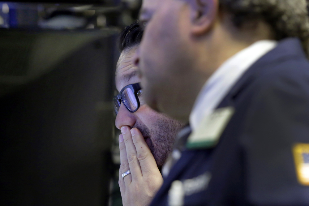 Trader Leon Montana, left, works on the floor of the New York Stock Exchange on Wednesday. Could the U.S. economy be slowing?