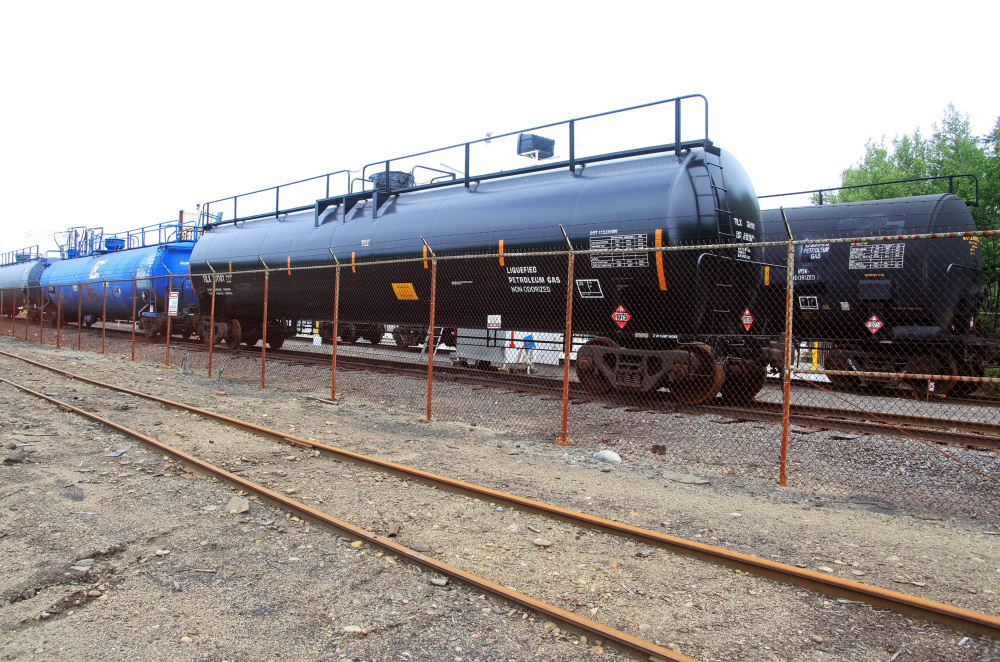 Pan Am Railway tanker cars that carry propane are parked at the NGL Supply Terminal in Portland in 2013. New development is forcing NGL to move its propane depot elsewhere.