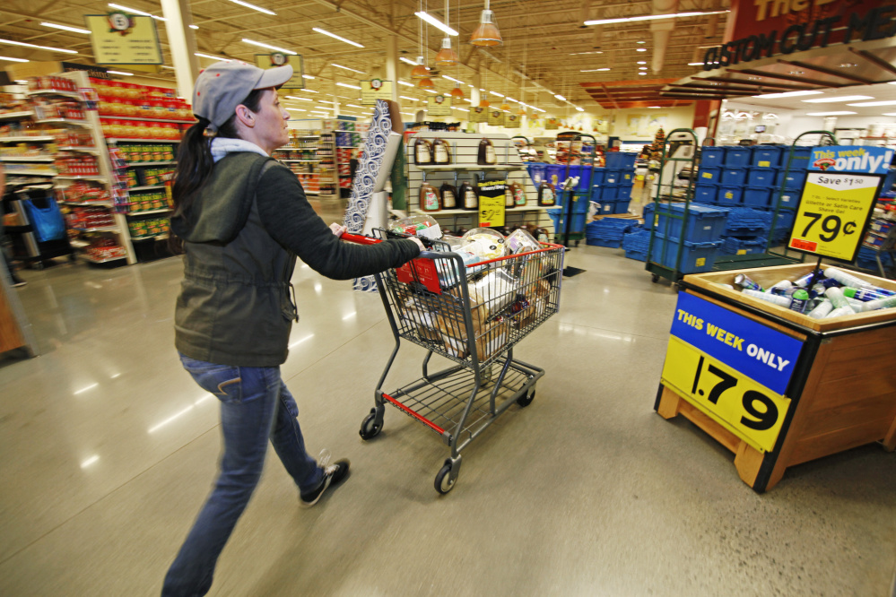 Shortly after 6 a.m., Shannon LeBlanc, bakery service leader, wheels cakes and other bakery items past their selling dates to Hannaford's loading dock for food pantry collection. Jill Brady/Staff Photographer