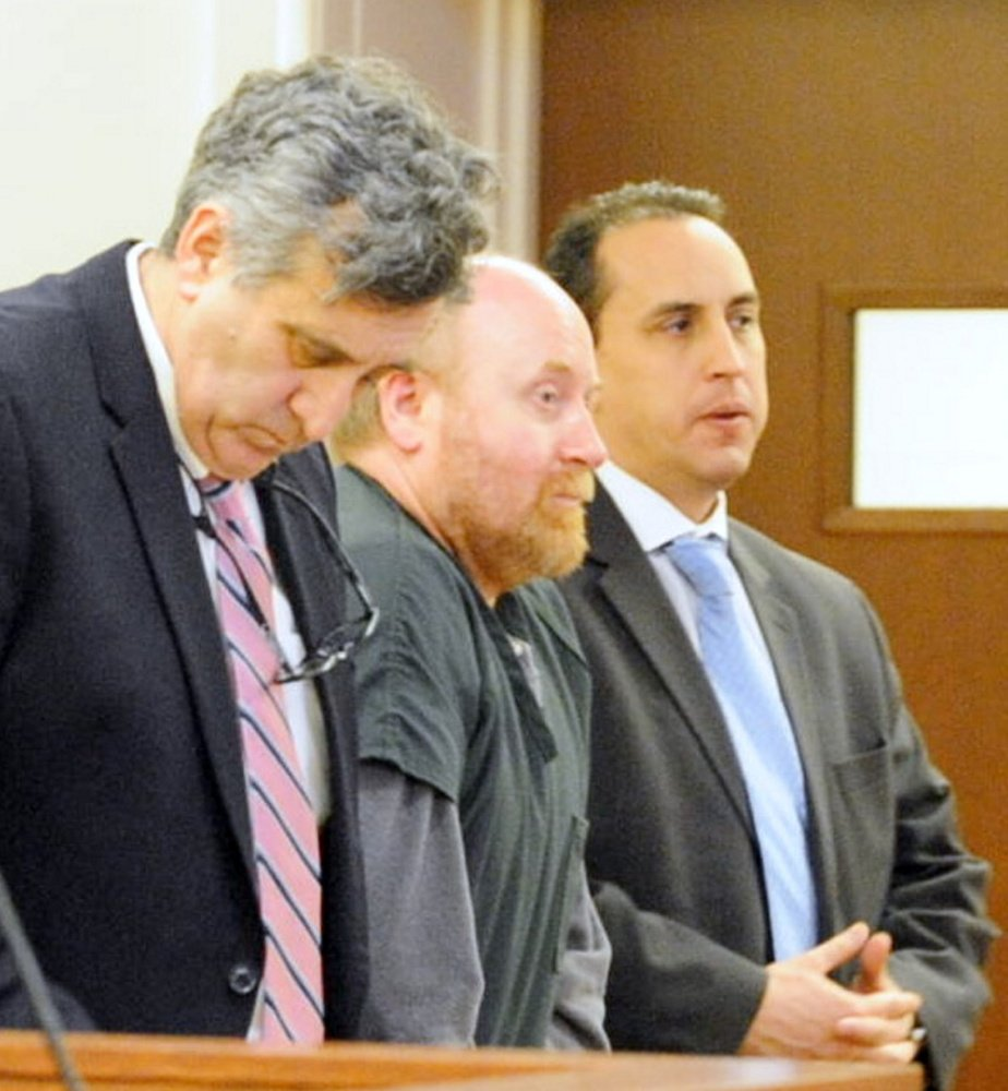 Attorneys Ronald Bourget, left, and Darrick Banda, right, stand with Roland Cummings on Thursday during Cummings' sentencing at the Capital Area Judicial Center in Augusta. Cummings was sentenced to life in prison.