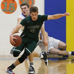 Waynflete's Milo Belleau drives away from the defensive pressure of Lake Region's Jack Lesure on Thursday night. Belleau scored a team-high 17 points.