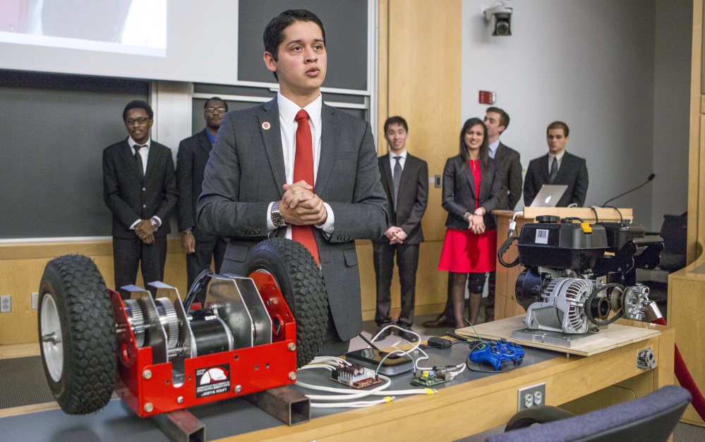 Harvard junior Cesar Maeda explains a robotic remote-control rooftop snowblower. Eighteen juniors also invented a super-heated icicle cutter and a freeze-resistant doormat.