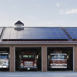Rooftop solar, like this array on top of the Belfast Fire Department, contributes 1 percent of the power that Central Maine Power delivers.