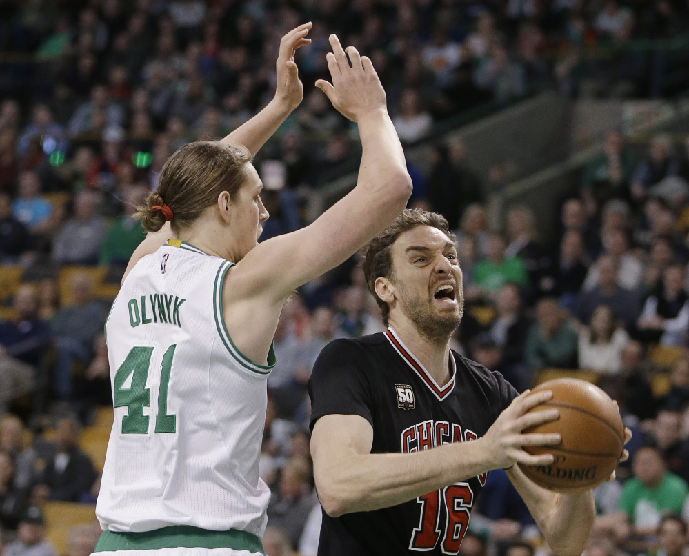 Bulls center Pau Gasol drives to the basket past Celtics center Kelly Olynyk in the first quarter of the Celtics' win Friday night in Boston.