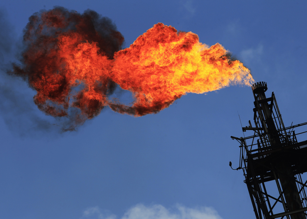Gas is flared-off at an oil facility. Between 2009 and 2014, enough was lost through flaring, venting and leaks to power more than 5 million homes for a year.