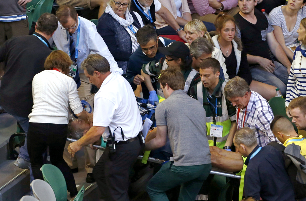 Nigel Sears, coach of Serbia's Ana Ivanovic, is carried on a stretcher from Rod Laver Arena following a medical emergency during Ivanovic's third round match against Madison Keys of the United States at the Australian Open in Melbourne, on Saturday.