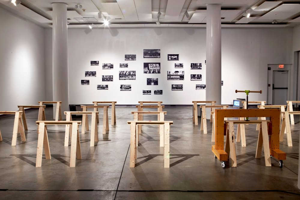 """Sawhorses, Adam Manley. At right is the device that will be used to break the backs of the sawhorses at regular intervals during the run of """"Tinderbox."""""""
