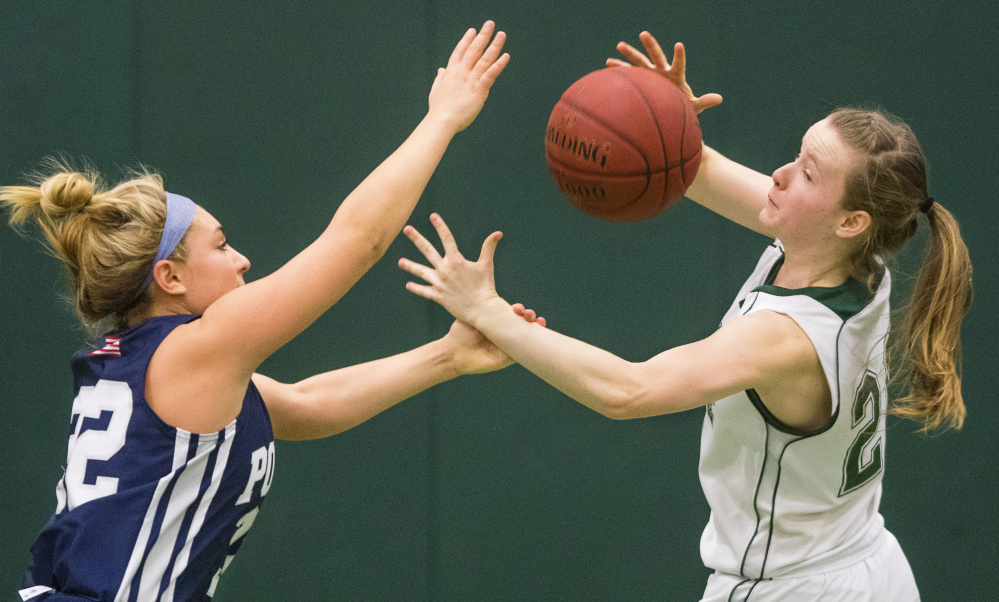 Poland guard Sarah Bolduc, left, battles for a loose ball with Waynflete's Arianna Giguere during their Western Maine Conference basketball game Saturday in Portland. Poland won, 52-40.