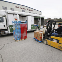 Andy Poulin, a driver for the Good Shepherd Food Bank in Auburn, loads pallets of food into the Mobile Food Pantry truck headed for Dover-Foxcroft.