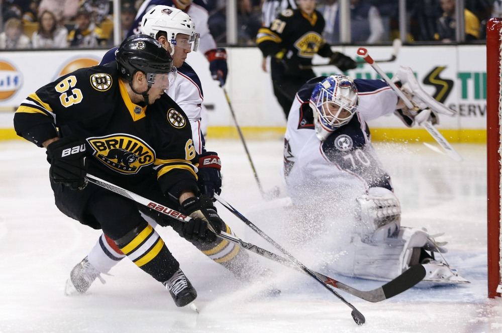 Brad Marchand of the Bruins sends a backhander past Columbus goaltender Joonas Korpisalo for a second-period goal Saturday night. Boston won in a shootout.
