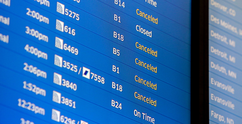 Flight boards at O'Hare International Airport show cancellations Friday in Chicago.