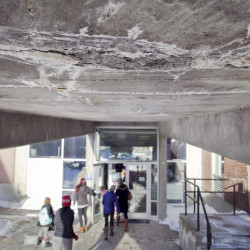 A section of crumbling concrete is seen Friday on the underside of a ramp at the Howard C. Reiche Community School in Portland. ( Joel Page/Staff Photographer)