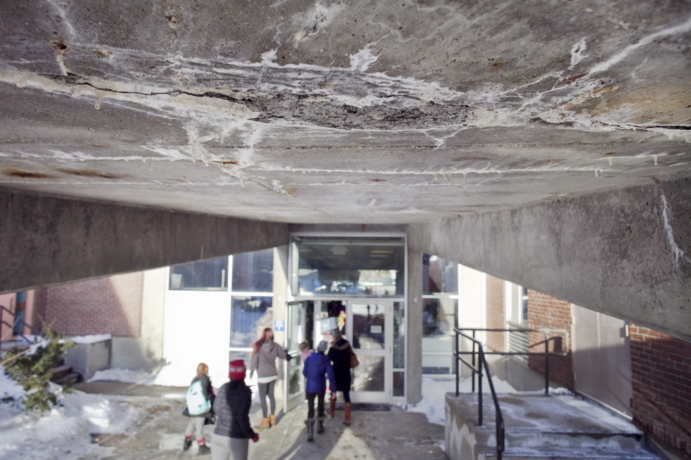 A section of crumbling concrete is seen in January on the underside of a ramp at the Howard C. Reiche Community School in Portland. The school would get $17.9 million worth of repairs and improvements under the proposed borrowing plan. Joel Page/Staff Photographer