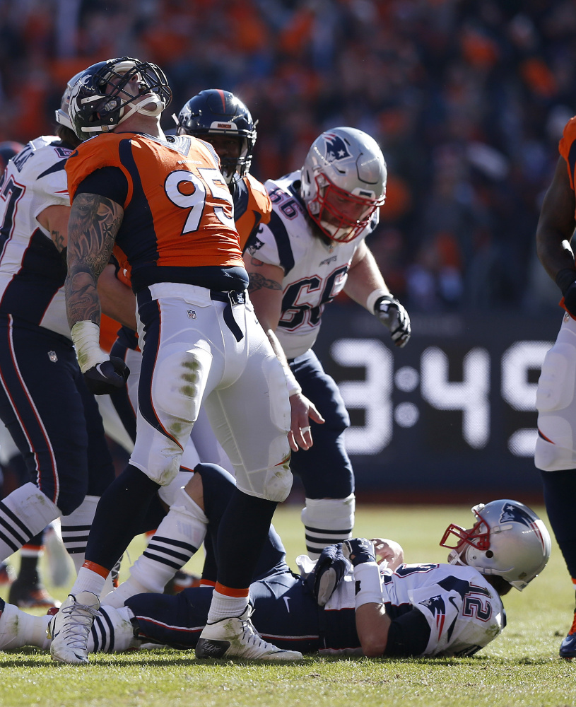 Broncos defensive end Derek Wolfe celebrates after sacking Patriots quarterback Tom Brady during the first half of the AFC championship game won by Denver. The loss cost New England a chance to defend its title in the Super Bowl against the Carolina Panthers.