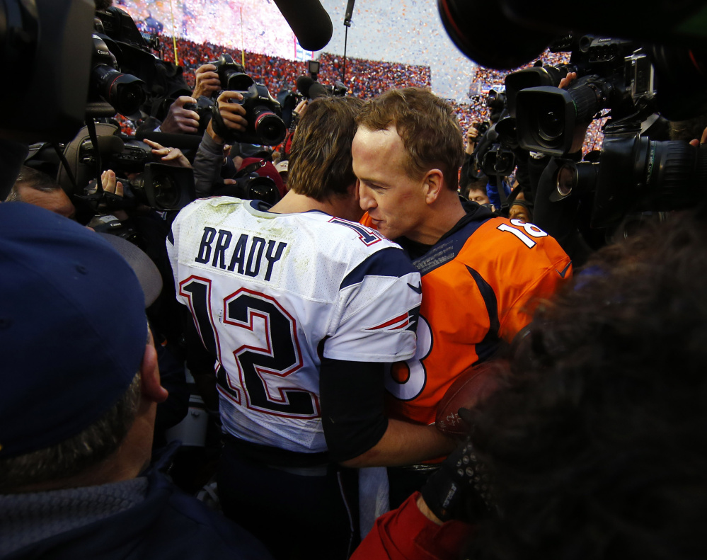 At top, a bleeding and battered Tom Brady gets up after yet another hit in the second half of the AFC title game. Above, he talks with Denver's Peyton Manning after the Broncos' 20-18 victory. More coverage in Sports, C1