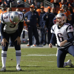 New England Patriots punter Ryan Allen (6) looks on as Patriots kicker Stephen Gostkowski reacts after missing an extra point following a touchdown by Steven Jackson during the first half of the AFC Championship game  Sunday. (AP Photo/Chris Carlson)