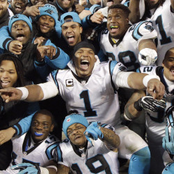 Quarterback Cam Newton, center, and the Carolina Panthers celebrate after beating Arizona 49-15 in the NFC championship game Sunday in Charlotte, North Carolina.