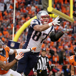 Patriots tight end Rob Gronkowski leaps in front of Broncos cornerback Chris Harris to catch a 4-yard touchdown pass late in the AFC championship game Sunday. The touchdown pulled New England within 20-18, but the Patriots missed the 2-point conversion.