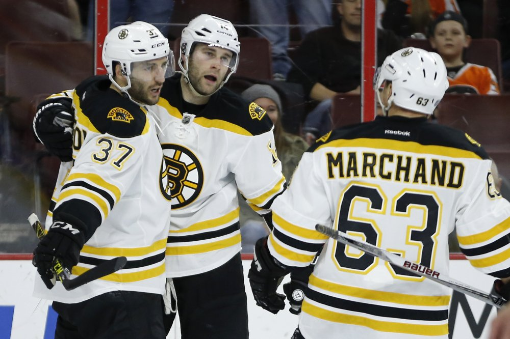 Bruins, from left, Patrice Bergeron, Brett Connolly and Brad Marchand celebrate Connolly's game-winning goal.