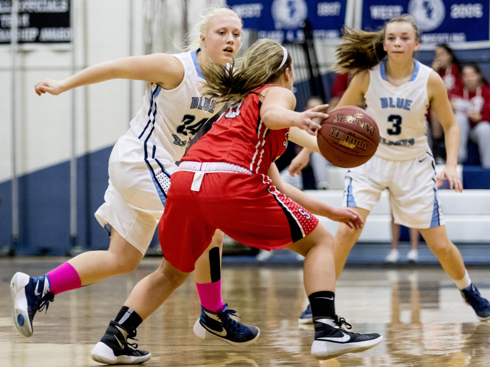 Sanford's Summer Camire, center, looks for room to drive against the Westbrook full-court press Tuesday night.