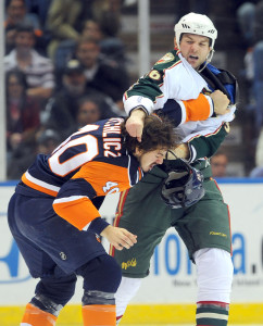 """John Scott brawls with an opposing player in 2009, when Scott was a member of the NHL's Minnesota Wild. On his captaincy this year, Scott said: """"I'm not the normal All-Star."""""""