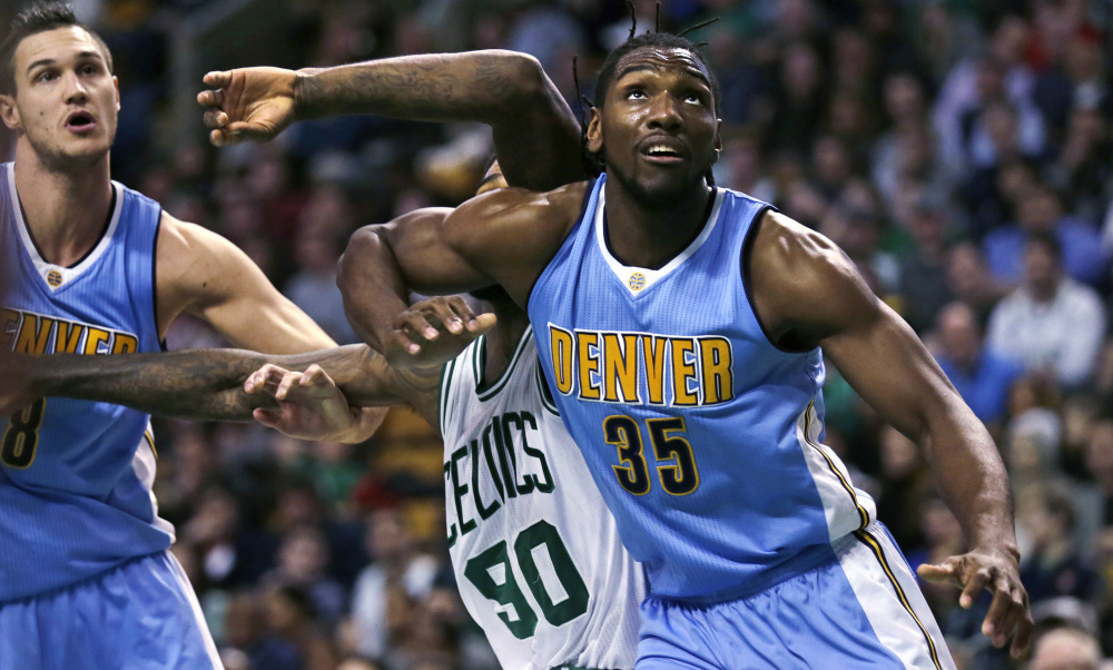 Nuggets forward Kenneth Faried blocks out Boston's Amir Johnson on a rebound in the second quarter Wednesday night in Boston.