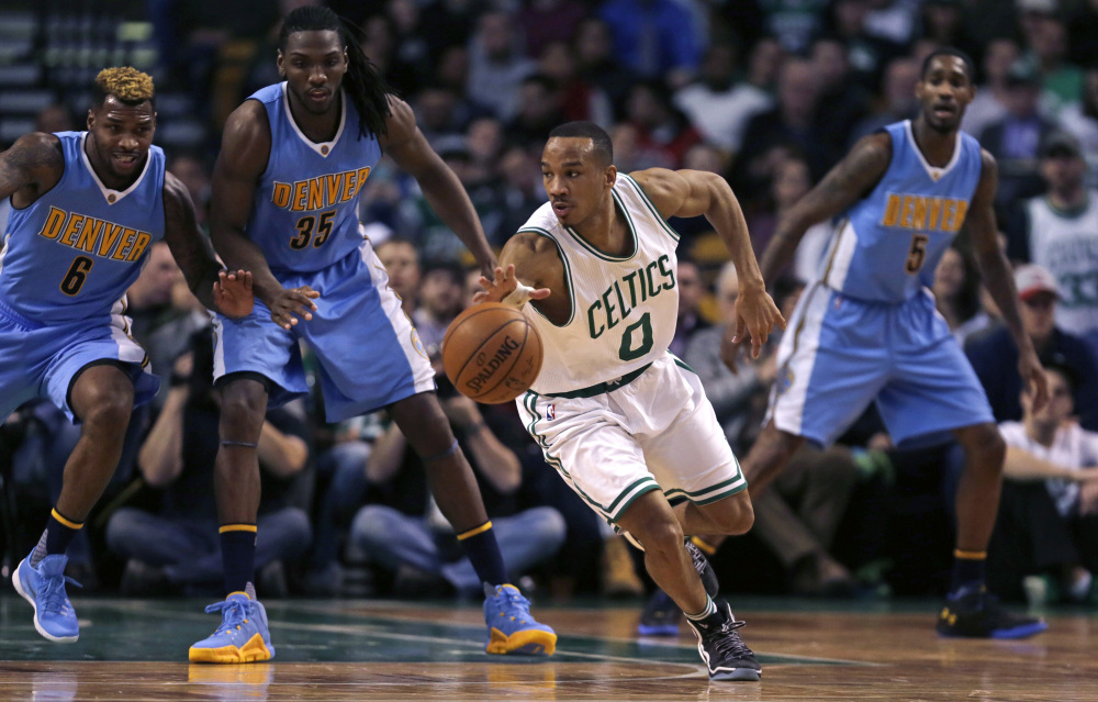 Celtics guard Avery Bradley looks to pass as he threads through Denver's defense in the second half Wednesday at Boston. Bradley scored 27 points in Boston's 111-103 win.