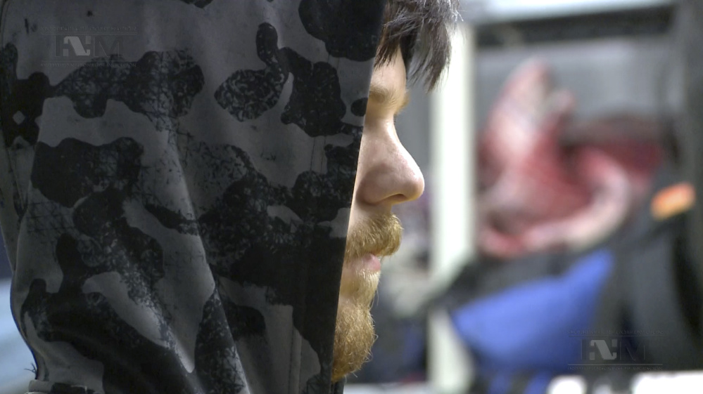A hooded Ethan Couch, is processed by Mexican immigration agents, in Mexico City. before being escorted onto a commercial plane, en route to Dallas.