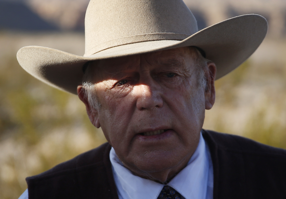 Rancher Cliven Bundy, the father of Ammon and Ryan Bundy, speaks to media near his ranch Wednesday in Bunkerville, Nev. Cliven Bundy and his wife, Carol Bundy, were returning from a trip to visit the family of LaVoy Finicum, a 55-year-old rancher from Cain Beds, Ariz., who died Tuesday after being shot by law enforcement officers.
